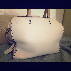 Coach Rogue with Border Rivets In Chalk